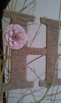 A simple wooden letter bought from the craft store wrapped in hemp with a flower all for under $3
