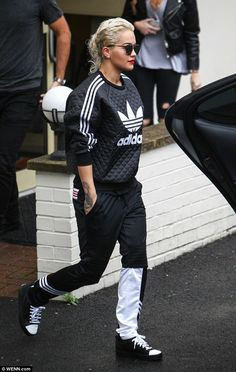 Fashionista: The Body on Me singer put her most fashionable foot forward in a quilted black and white Adidas jumper as she whipped her girls into shape ahead of tomorrow's performances