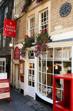 Sally Lunn's House Described as the oldest house in Bath dating from 1483 (even though it seems part of a terrace). Sally Lunn was the creator of the famous Sally Lunn Bun, (exceptionally light semi sweet bread), the house is now a living museum. Places To Go, Places Ive Been, Shop Fronts, Lovely Shop, Shop Around, English Countryside, England Uk, Architecture, Windows