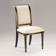 Regency style carved wood side chair with black finish, antiqued goldleaf trim and striped ivory upholstery. Made in Italy.