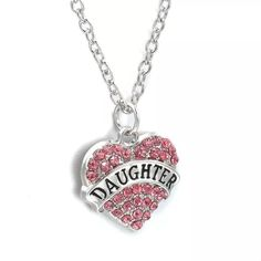 Daughter Necklace Cute silver tone zinc alloy necklace. Chain is about 25 inches plus an additional 2 inch extender. This has pink rhinestones. New in package. Jewelry Necklaces