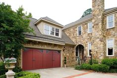 Amarr Bob Timberlake® Collection: Claremont with Seeded Glass wood carriage house style garage door. Visit www.amarr.com for more great styles.