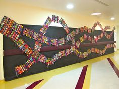 Fun way to display 1st grade paper weavings