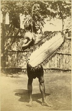 A full length portrait of a Zande man wearing a feather headdress and holding a fringed wicker-work shield and long throwing knife. The Makaraka (this name for the Zande of the Odio area seems to be of Mittu origin) were part of the Zande kingdom and speak a dialect of the Zande language. Buchta made an excursion to Makaraka country setting out from Juba on 7th July and returning there on 26th August 1879.