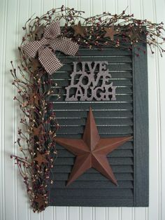 This is a Pretty Prim (a prettied up primitive look) shutter...with rusty stars & berries.