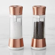 The slim, tapered shape of OXO's Lua mills takes on new brilliance when clad in rich copper. These salt and pepper mills are a favorite of cooks, thanks to their mess-free design. The mills grind and serve from the top, so tables and counters stay… Kitchen Supplies, Kitchen Items, Kitchen Gadgets, Kitchen Tools, Kitchen Utensils, Cooking Utensils, Kitchen Decor, Copper Kitchen Accents, Rose Gold Kitchen