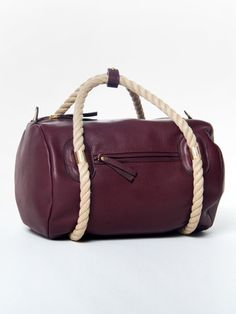 Sea Duffel oxblood barrel bag with contrast natural rope handles by AANDD. Front view.