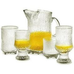 Ultima Thule Glassware By Tapio Wirkkala For Iittala. Developed in the pattern is created when the molten glass burns into the surface of the wooden moulds. Finland Food, Classic Glasses, Short Glass, Mirror Mosaic, Clean Dishwasher, Marimekko, Helsinki, All Modern, Colored Glass