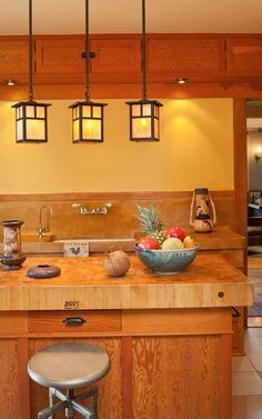 Arts & Crafts-style fixtures add ambiance to this bungalow kitchen. Photo: William Wright
