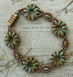 "SUPERDUO FLOWER CHAIN BRACELET   11/0 seed beads ""Dark Bronze"" (11-457D)   SuperDuo beads ""Light Blue Picasso""     I don't remember whe..."
