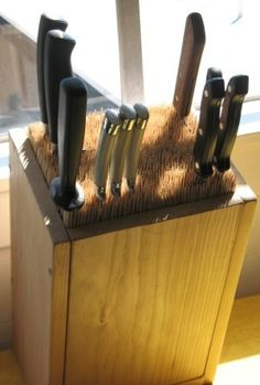 Fill an old box with skewers to make an all-purpose knife block