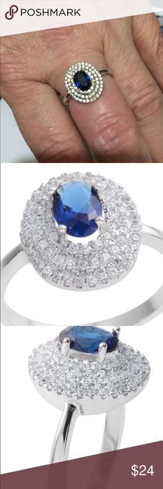 Simulated Blue Diamond Ring Size 8.5 Brand New Brand New and delivered in gift 🎁 Box. Surrounded by a sea of shimmering Simulated diamonds,  the Simulated blue diamond sits proud in the center of the blissful island.   This beautiful ring is sure to put jazz in your style!  TSW 1.77 Cts.  Size 8.5 Jewelry Rings
