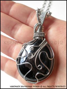 This reminds me of strange SF Octopus, which just consumed this onyx look-alike glass stone. :)    Glass stone + inox wire + long chain (70 cm)    Size: 6,5 x 3,5 cm