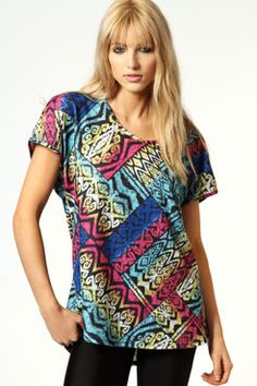 Minnie Rainbow Aztec Brushed Knit Oversized Tee £15 >> http://www.boohoo.com/day-tops/minnie-rainbow-aztec-brushed-knit-oversized-tee/invt/azz57022    I really like the crazy fun vibe this top creates!  i think it would look good tucked into a highwaisted skirt, jeans , or shorts!