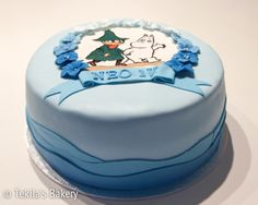 Moomin cake with snufkin. Blue flowers and waves