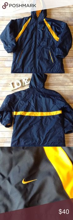 """Nike Reverisble navy blue &yellow coat/jacket Pre-owned Nike men's Reverisble navy blue and yellow coat/jacket size medium. Very good used condition. No rips holes or stains. One side is 100% nylon and the other is 100% polyester. Great coat!   Measurements:  Armpit to armpit- 25""""  Armpit to sleeve- 20""""  Length- 31""""   I ship fast! Pay before 4:30pm Monday thru Friday and I will ship the same day!  Thank you for looking!  Check out my other items! Nike Jackets & Coats"""
