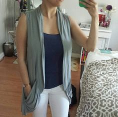 Cardigan vest Light grey, 100% rayon cardigan vest thing. Not sure what you call these!  It has cute pockets and fun detail at the hem. Decree Sweaters Cardigans