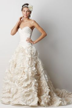 I love the idea of dresses with texture, but I'm afraid I would look like an oompa loompa in this :) #wedding #dress