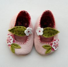 These sweet little booties are made from wool blend felt, cotton fabric, and have button embellishments as well as my own hand-cut and stitched appliques. The leaf strap is elasticised so they slip on easily.