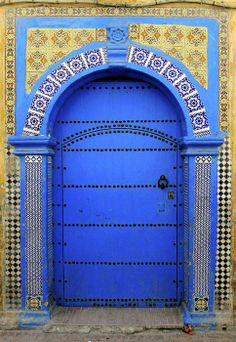 Love the intense rich colors, height and materials used in Moroccan doors