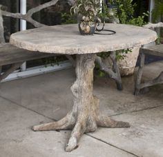 This is one of the coolest concrete tables I have ever seen! You could probably make one yourself with help from cfa-online.com