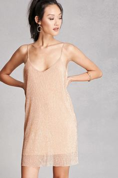 A knit shift dress featuring a pleated metallic shimmer design, a V-neck and back, cami straps, and a raw-cut hem. This is an independent brand and not a Forever 21 branded item.