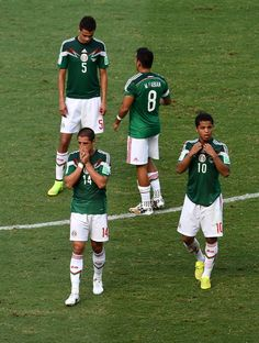 Netherlands Stuns Mexico With Late Goals To Reach World Cup Quarterfinals - Diego Reyes, Marco Fabian, Javier Hernandez and Giovani dos Santos of Mexico look on after being defeated by the Netherlands 2-1 during the 2014 FIFA World Cup Brazil Round of 16 match between Netherlands and Mexico at Castelao on June 29, 2014 in Fortaleza, Brazil. (Photo by Jamie McDonald/Getty Images)