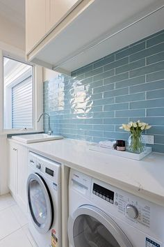 A small laundry room can be a challenge to keep laundry room cabinets functional, yet since this laundry room organization space is constantly in use, we have some inspiring design laundry room ideas. Laundry Room Tile, Farmhouse Laundry Room, Laundry Room Organization, Room Tiles, Basement Laundry, Wall Tiles, Laundry Area, Laundry Storage, Farmhouse Small