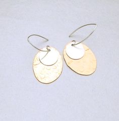 sterling Silver and Copper drop earrings is a beautiful combination of textured copper and sterling silver.  Designed by www.MaryeBrenda.com $54