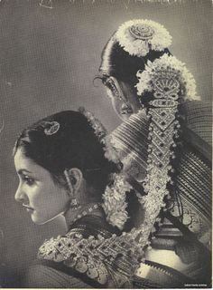 Vintage India - lady with a 'jadai nagam' (hair braid ornament in the shape of a cobra hood ), and a silk saree with a paisely border.
