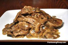 Lengua-in-Mushroom-Sauce Ox Tongue in Mushroom Sauce.