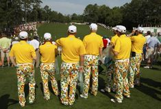 A group of spectators watch from behind the first tee during first-round play in the 2012 Masters golf tournament at the Augusta National Golf Club in Augusta, Ga.
