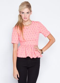 """Be pretty in pink in the Magnus Top by Cameo. Features peplum style bottom with 3/4 length sleeves.    100% cotton  24"""" length  Model is wearing size S"""