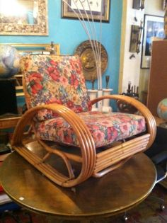 This 1950s bamboo club chair has sloping arms and a very retro floral patterned cushion.