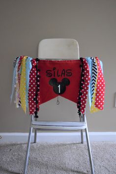 Red, yellow, blue and black first birthday Mickey Mouse themed highchair banner. Matching shirt available! Handmade by Madsy Bella Boutique, sold on Etsy. Mickey Mouse First Birthday, First Birthday Banners, Fabric Tutu, Birthday Highchair, Wall Banner, Party Banners, High Chair Banner, Sell On Etsy, Manualidades