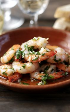 Super quick and easy garlicky prawns are perfect as part of a tapas dinner or as a Spanish-style starter. Ole!