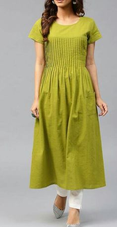 Buy AKS Green Cotton Solid A-Line Kurta online in India at best price.Green solid A-line kurta with pleated detail, has a round neck, short sleeves, flared hem, 1 pocket Stylish Dresses For Girls, Stylish Dress Designs, Dress Neck Designs, Designs For Dresses, Churidar Designs, Kurta Designs Women, Simple Kurti Designs, New Kurti Designs, A Line Kurta