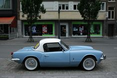 A MkII Spitfire; my first car. Mine was this colour, with the removable hard top  soft top and was a whole lot of fun. I purchased the hard top second hand and transported it home on the rear seat (!) of my other car, an Austin 1800 MkII  (The Land Crab).