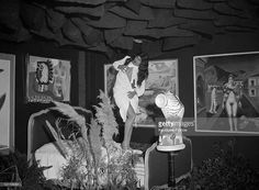 FRANCE - CIRCA 1938 Surrealist Exhibition S Just Open In Paris In Faubourg Saint-Honore Attitude Of Miss Helene Vanel In His 'Dance Around The Brazier' In A Very Surreal Setting, Or The Sky Is Full Of Bags Of Charcoal On January 18Th, 1938