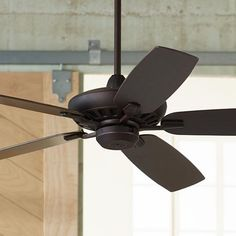A refined ceiling fan design in oil-rubbed bronze with matching blades.This simple, stylish ceiling fan comes in a oil-rubbed bronze finish with matching blades. This great looking fan includes a remote control for easy operation. A smart addition to living rooms, kitchens and more.