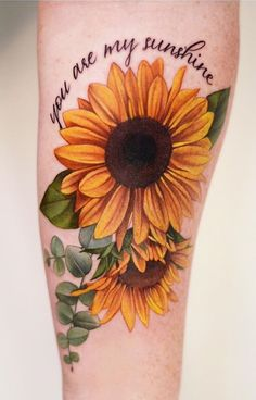 Celebrate the Beauty of Nature with these Inspirational Sunflower Tattoos – foot tattoos for women Sunflower Tattoo Sleeve, Sunflower Tattoo Shoulder, Sunflower Tattoos, Sunflower Tattoo Design, Shoulder Tattoo, Colorful Sunflower Tattoo, Forearm Tattoos, Body Art Tattoos, Small Tattoos