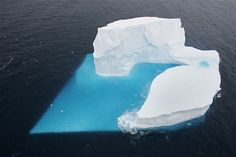 An iceberg in the Southern Ocean, off the coast of Antarctica, forms into the shape of a heart