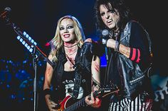 Singer Alice Cooper accompanied by the guitarist Nita Strauss during a concert at the Alcatraz Milan Italy 14th June 2016