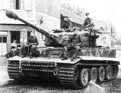 "thebeautyandthehorror: "" A Tiger I of PzAbt 502 advances on a road through a Russian village near Leningrad, 1943. """
