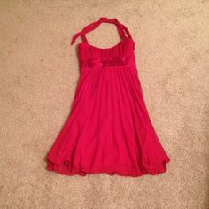 Love Tease Halter Dress Love Tease Red Halter Dress. Skirt is pleated. Zips in the back. Love Tease Dresses