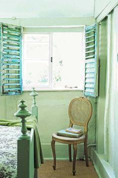 rustic bedroom with hemlock green painted walls and blue salvaged interior shutters, hemlock green from pantone color of month may 2014