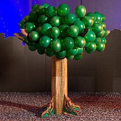 Balloon Tree features a wood pattern trunk with green balloons as the features. Each Balloon Tree measures 8 feet high x 8 feet wide and the base is made from cardboard. Balloon Tree, The Balloon, Cardboard Tree, Small Balloons, Wood Crafts, Diy Crafts, Fake Trees, Stage Props, Mystery Parties