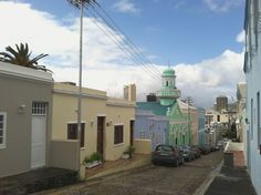 """Bo Kaap Known as the """"Upper City"""", or the Malay Quarter, this colorful series of streets has historically been home to Cape Town's Muslim population and cape Malay culture. Here, visitors can stop by local spice markets, take a scenic walk, and generally experience one of the city's most celebrated historic areas. Photo by Laura Feinstein."""