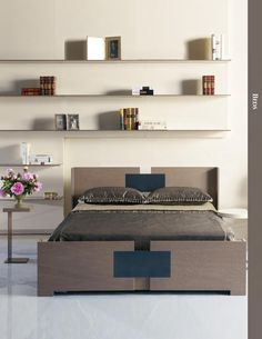 BEDS Beds have had architectural aspirations before - remember the pier wall beds of the '70's? But in the hands of Marc Desplaines, the Symmetrical High Bed makes good on the promise. Upholstered panels dress the headboard, here flanked by freestanding French Series nightstands. In king, California king, and queen sizes.