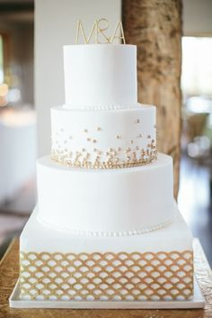 White and gold cake: http://www.stylemepretty.com/texas-weddings/dripping-springs/2015/03/05/chic-spring-wedding-at-camp-lucy/ | Photography: Taylor Lord - http://www.taylorlord.com/